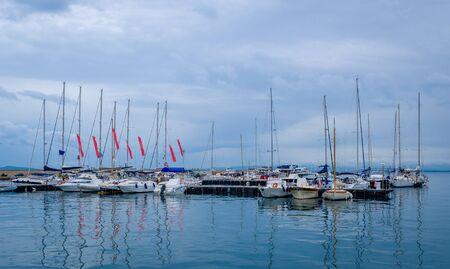 Sailing boats at Porto Santo Stefano marina. Toscana, Italy