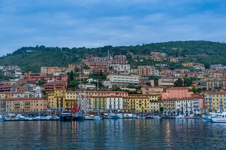 Porto Santo Stefano old town view from the water at early norning light. Toscana, Italy