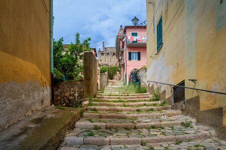 Santo Stefano old town narrow street going uphill. Toscana, Italy