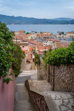 Tiny street goes down to Potriferraio port, Elba island, Italy