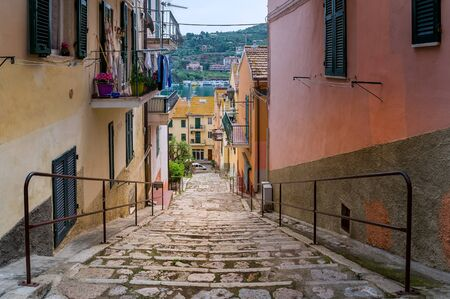 Old town downhill street of Santo Stefano, Toscana, Italy