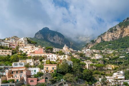 Landscape of Positano village with mountain range on the background. Amalfi coast, Italy.