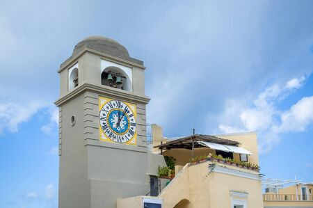 Tower with old clock and bells. Center of Capri town. Amalfi coast, Italy. 版權商用圖片