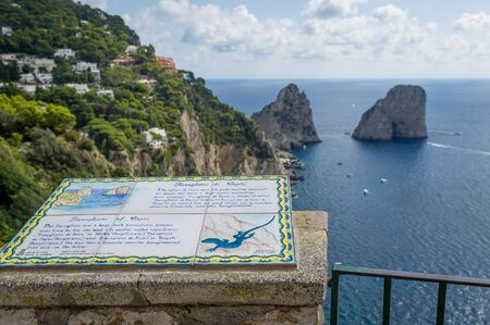 Faraglioni rocks view and tourists information table. Capri island viewpoint, Italy. 版權商用圖片