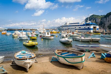 Marina di Capri harbor with fishermans boats and cruising vessels. Amalfi coast, Italy. 版權商用圖片