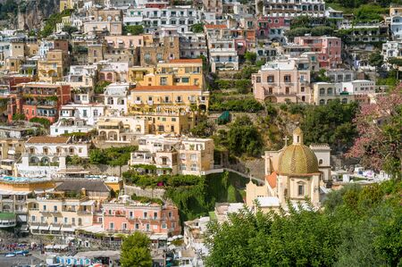 Close up view of Poasitano village streets. Traditional colorful houses at the hill. Amalfi coast, Italy.