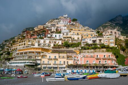 Small boats at Positano beach. Popular travel destination of Amalfi coast, Italy.