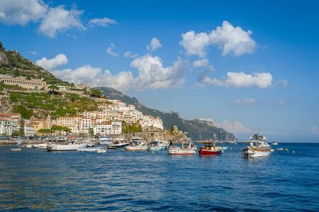 Traditional local fishermans boats at anchor in Amalfi, Italy. 版權商用圖片