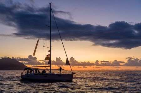 Sailing boat silhoette at sunset sky background. Amalfi coast sailing, Italy. Standard-Bild