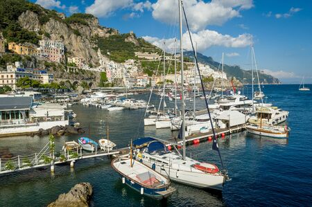 Amalfi old town and harbor panorama. Popular travel attraction of Italy coast.