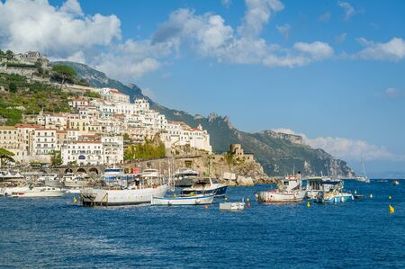 Amalfi town on the hills and fishermans boats at summer day in Italy. 版權商用圖片