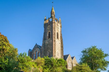 Parish Church tower on the hills of Tarbert. Landmarks of Scotland.