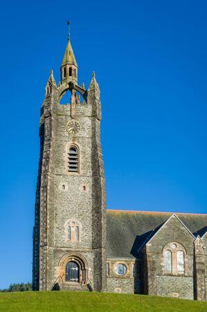 Vertical photo of Tarbert Parish Church tower. Hebrides, Scotland.