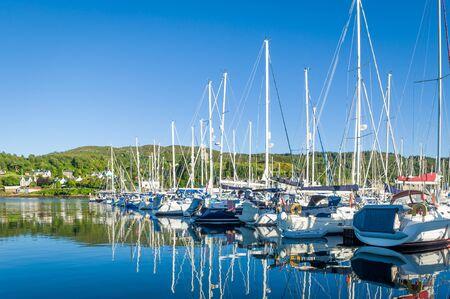 Sailing boats docked at Tarbert marina. Inner Hebrides, Scotland.