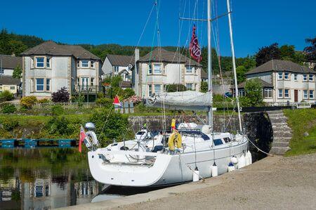 Modern sailing boat docked next to Ardrishaig gates. Crinan channel, Scotland.