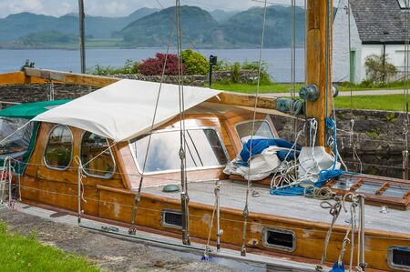 Old wooden boat, classical retro style. Crinan canal, Scotland.