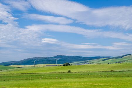 Green fields and windmills of Kintyre peninsula, Scotland