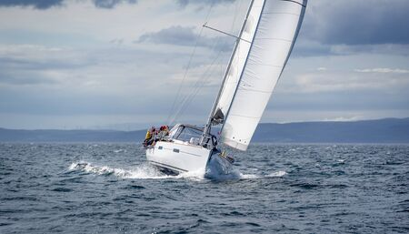 New sailing yacht going fast and beautiful directly on the camera. Sailing regatta in Scotland waters. Stock fotó