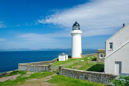 Davaar island white lighthouse and cottadges. Campbeltown, Scotland