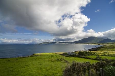 beautiful landscape with the green fields and the sea in Connemara, Ireland photo