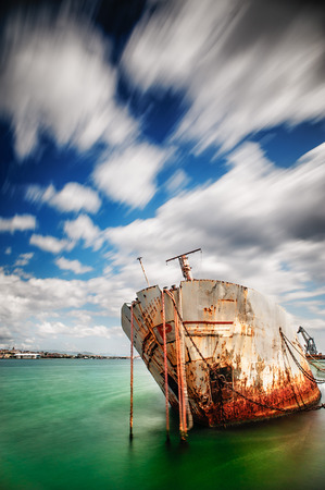 Shipwrek in the harbor - long exposure - color version photo