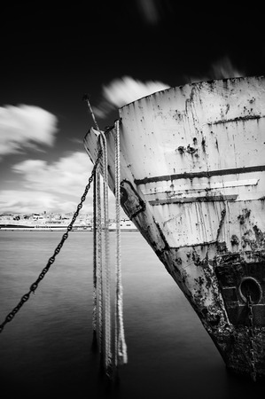 Prow of a ship wreck in the harbor- long exposure - black white version photo