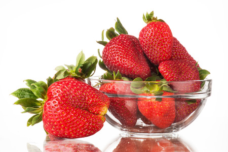 Strawberries in a glass bowl isolated white background photo