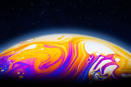 Alien planet in the cosmos, colorful soap bubble film photo