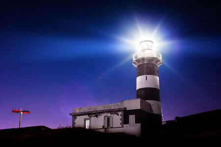 Lighthouse in the night photo