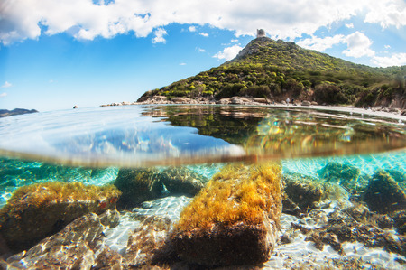 Mediterranean coast overlooking the crystal clear sea with rocks of various shapes - Under over sea