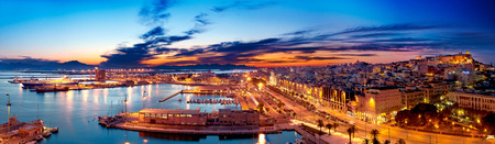Panoramic view of Cagliari by night 写真素材