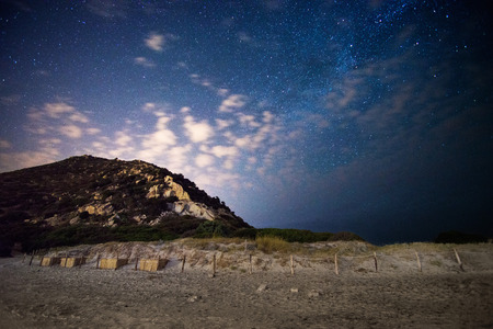 observatory: beach at night under the stars and the tail of the Milky Way Stock Photo