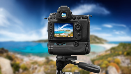 photography session: Dslr camera shooting in a beautiful seascape