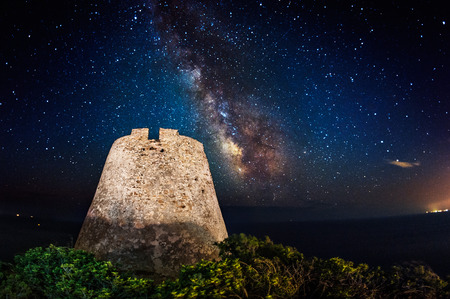 Ancient coastal tower under the milky way photo