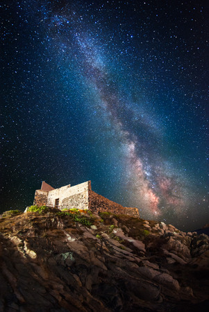 Ancient fortress at night under the milky way