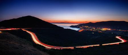 Coastal landscape at dusk with light trails Stockfoto