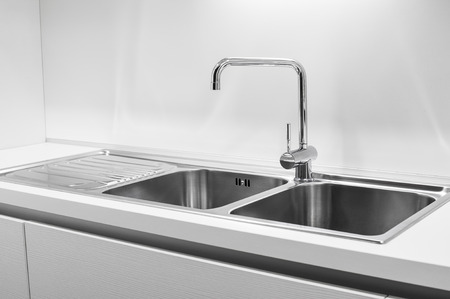 sink drain: Double bowl stainless steel kitchen sink Stock Photo