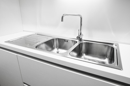 basin: Double bowl stainless steel kitchen sink Stock Photo