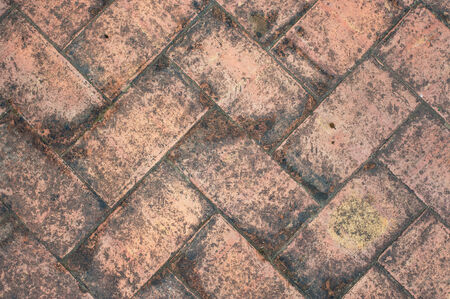 flooring: texture tile flooring crossed, aging effect by bad weather Stock Photo