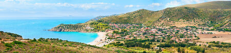 Panoramic view of the Mediterranean coast of Sardinia, with little town Solanas photo