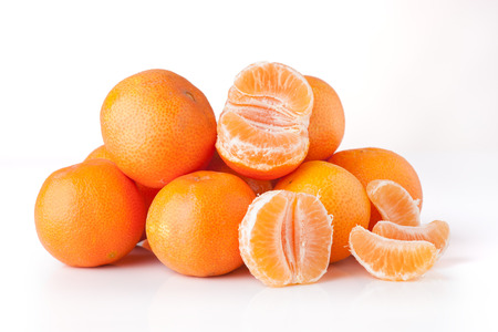 clementines: Clementines unpeeled and peeled - isolated Stock Photo