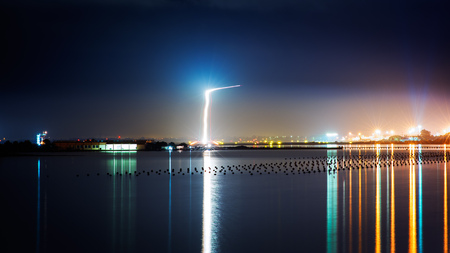 ronald reagan: Light trails of a plane Landing near the city by night Stock Photo