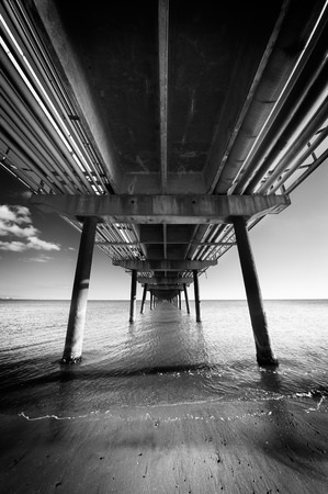 Under the pier in perspective photo