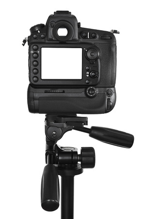 DSLR camera with blank screen on tripod isolated on a white background