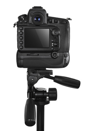 DSLR camera on tripod isolated on a white background