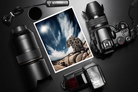 Camera equipment around a printed photo of a granite rock