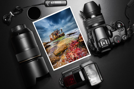 Camera equipment around a printed photo of a fisherman house