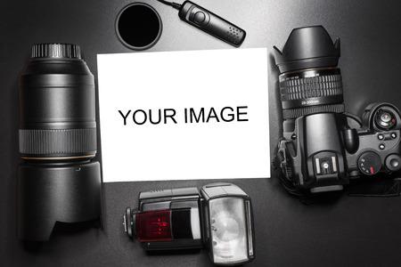 Camera equipment around a printed photo.