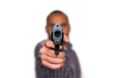 selectively: A man aims a semi automatic pistol. Selectively focused on the front of the gun. White background Stock Photo