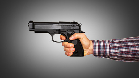 handled: Automatic pistol handled with one hand